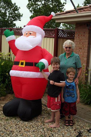 Mum and boys with Santa 13 Dec 09