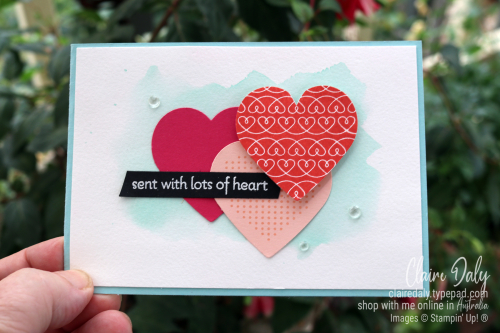 Stampin Up handmade card using new 2021 Lots of Heart stamp set. Has 3 overlapping punched coloured hearts and a watercolour background. By Claire Daly Stampin Up Demonstrator Melbourne Australia.