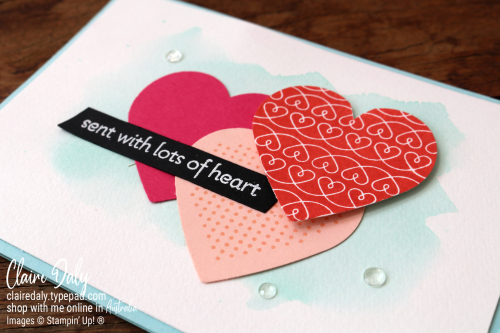 Stampin Up handmade card using new 2021 Lots of Heart stamp set. Has 3 overlapping punched coloured hearts and a watercolour background. By Claire Daly Stampin Up Demonstrator Melbourne Australia